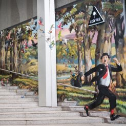 Business man running down stairs