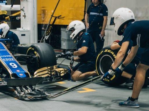 Mechanics changing wheels on car